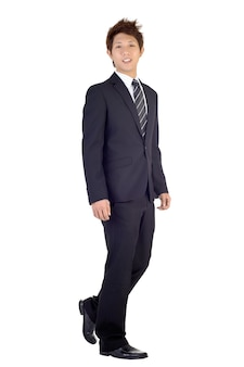 Happy smiling business man walking with smiling expression, full length portrait isolated over white wall.