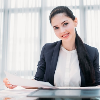 Happy smiling business woman in office workspace