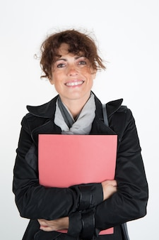 Happy and smiling businesswomen with financial reports.
