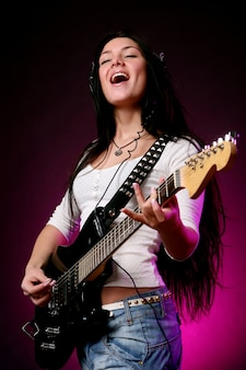 Happy smiling girl playing guitar