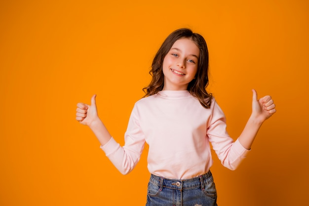 Happy and smiling girl with thumbs up