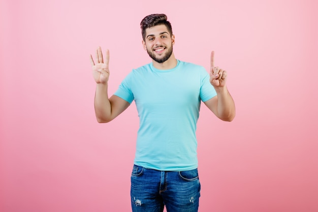 Happy smiling handsome bearded man showing five fingers
