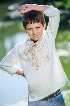 Happy smiling little boy dressed in national ukrainian style dress.