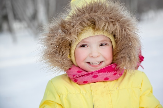 Happy smiling little girl in winter clothes