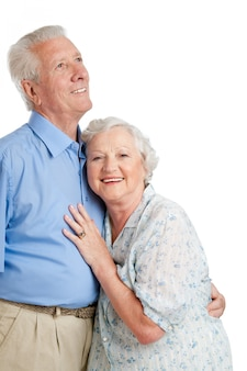 Happy smiling old couple standing together isolated on white  copy space