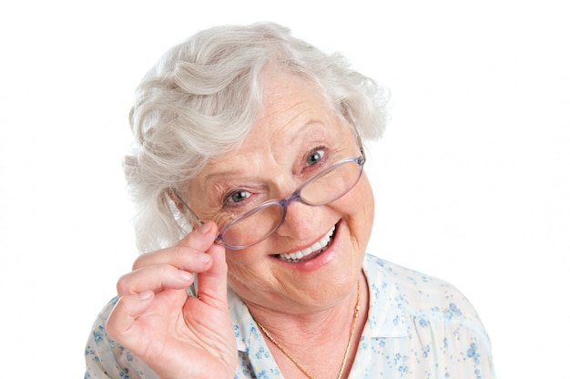 Happy smiling retired lady wearing her new pair of glasses isolated on white