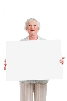 Happy smiling senior woman holding blank placard to write it on your own text, isolated on white