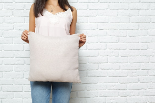 Happy smiling woman holding pillow