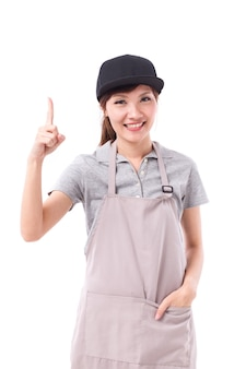 Happy, smiling woman worker pointing her finger up