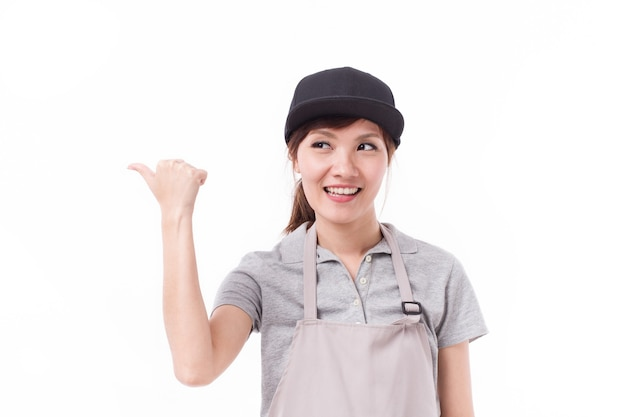 Happy, smiling woman worker pointing thumb up gesture
