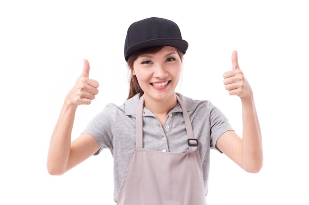 Happy, smiling woman worker pointing two thumbs up gesture