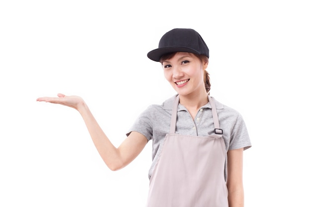 Happy, smiling woman worker presenting, pointing to blank space