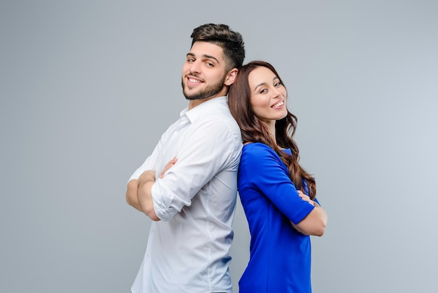 Happy and smiling young couple of man and woman isolated