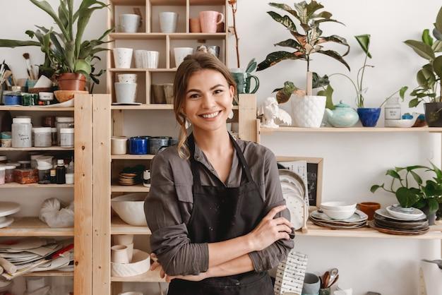 Happy smiling young female ceramist
