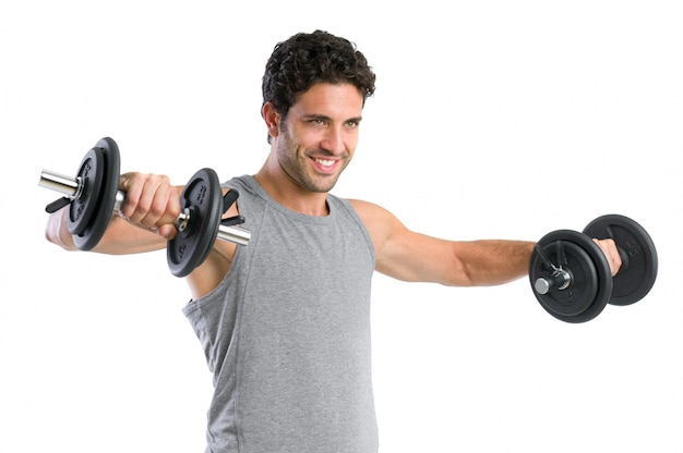 Happy smiling young man lifting weight isolated on white background