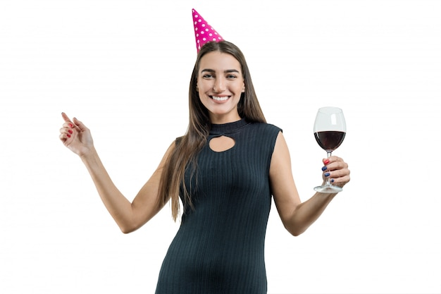 Happy smiling young woman with a glass of red wine