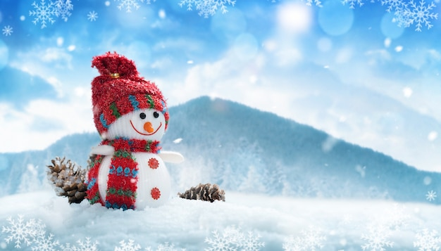 Happy snowman in red hat and scarf in winter scenery