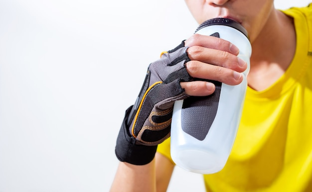 Happy sport man drink water in home living room for running, jogging, and exercise in fitness room