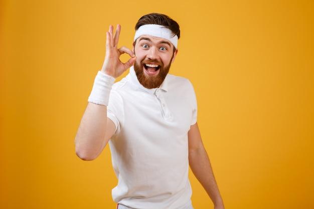 Happy sportsman showing ok sign