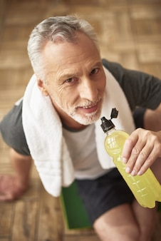Happy sporty old man face wellness active aging.