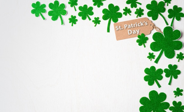 Happy st. patrick's day concept, st. patrick's greeting card with green paper clover leaf