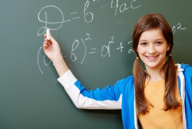 Happy student on the blackboard