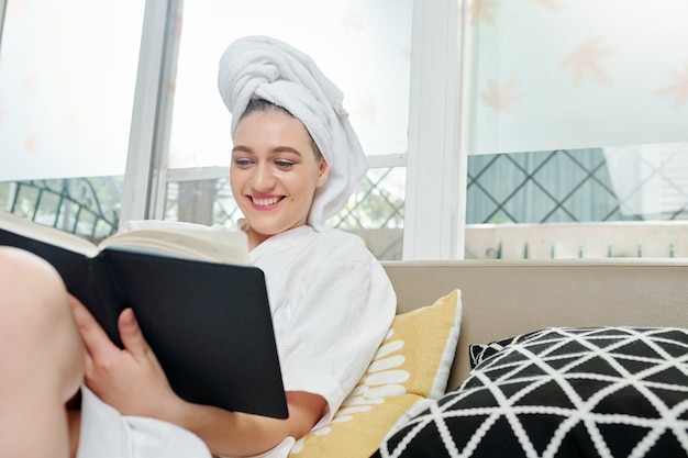 Happy student reading after shower