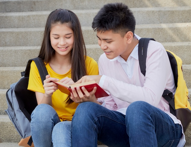 Happy students outdoor with books