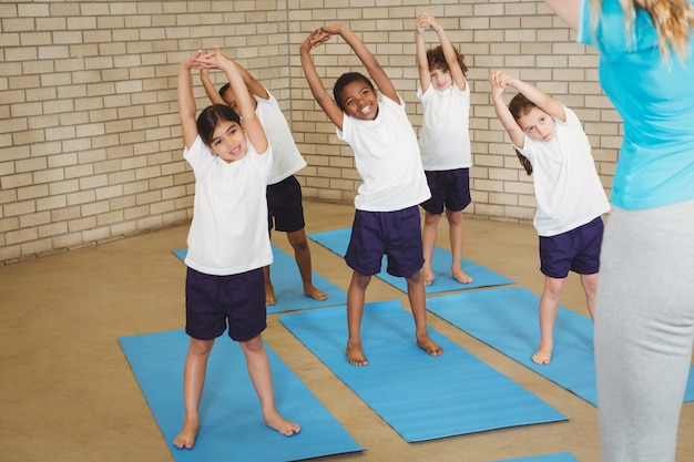 Happy students stretching out together