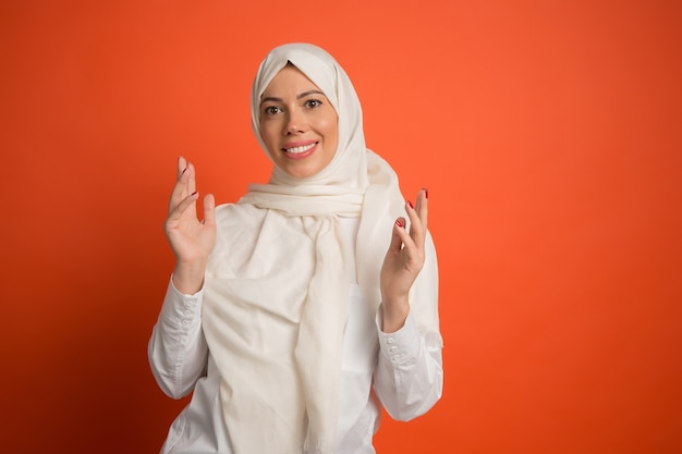 Happy surprised arab woman in hijab.