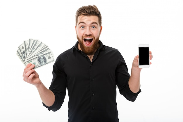 Happy surprised bearded business man in shirt holding money
