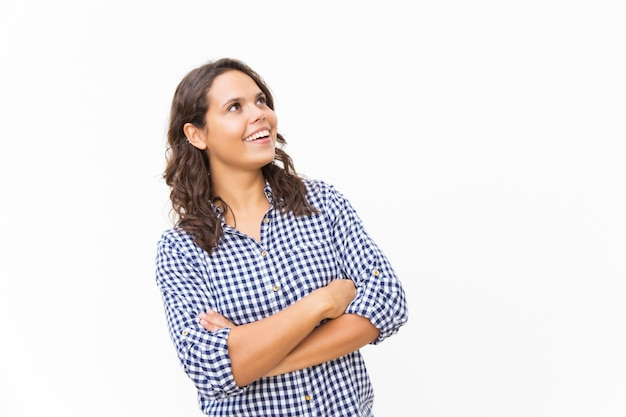 Happy surprised female customer staring up at copy space