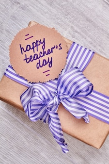 Happy teacher's day card. greeting paper and present box. congratulate your teacher.