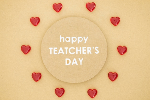 Happy teacher's day in a circle surrounded by hearts
