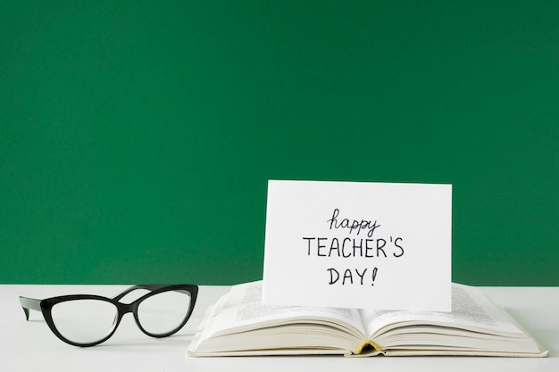 Happy teacher's day greetings card and reading glasses