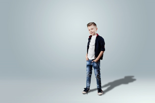 Happy teen boy studio portrait on white background