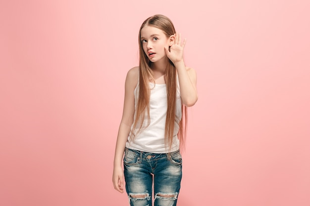 Happy teen girl standing and listening on trendy pink. beautiful female half-length portrait
