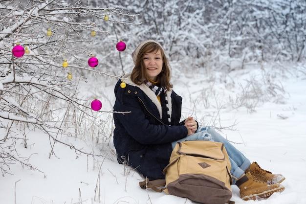 Happy teen girl on a winter walk on a snowy day, christmas