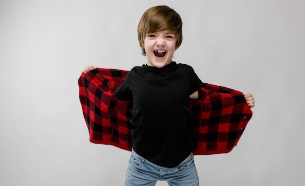 Happy teenage boy in fashionable clothes