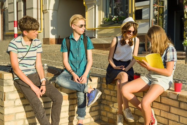 Happy teenage friends having fun