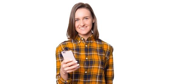 Happy teenager using mobile phone