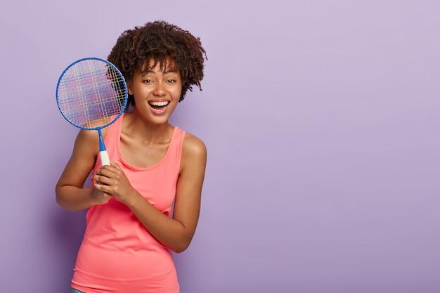 Happy tennis girl holds racket