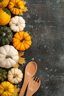 Happy thanksgiving background with decorative pumpkins and vintage wooden spoons