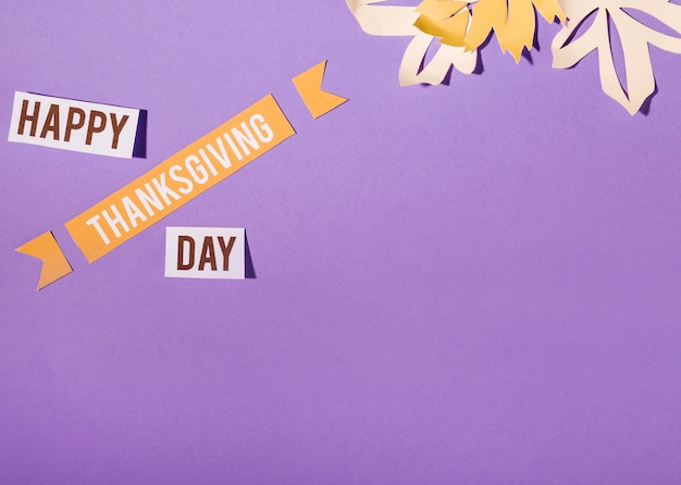 Happy thanksgiving day lettering on purple background
