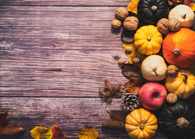 Happy thanksgiving day with pumpkin and nut on wooden table