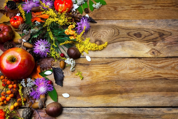 Happy thanksgiving decor with squash seeds on wooden