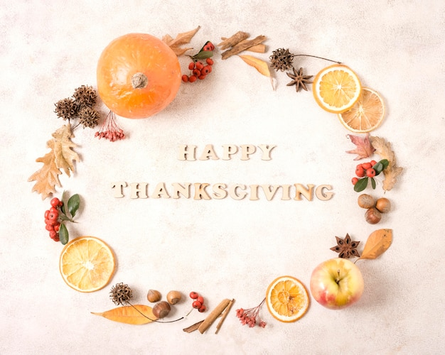 Happy thanksgiving frame with citrus and autumn leaves