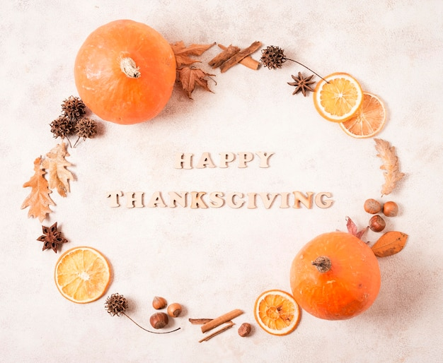 Happy thanksgiving frame with citrus and leaves