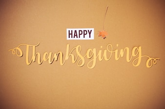 Happy Thanksgiving lettering on brown background