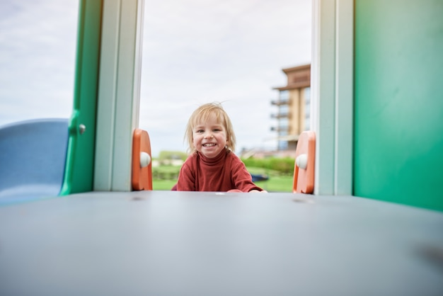 Happy toddler playing at the playground